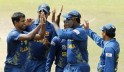 Sri Lanka's Kulasekara celebrates with his teammates after taking the wicket of India's Sehwag during their warm up match ahead of the World Twenty20 cricket series in Colombo