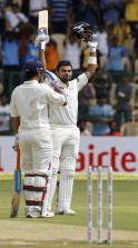 India's Kohli celebrates scoring a century during their second test cricket match against New Zealand in Bangalore