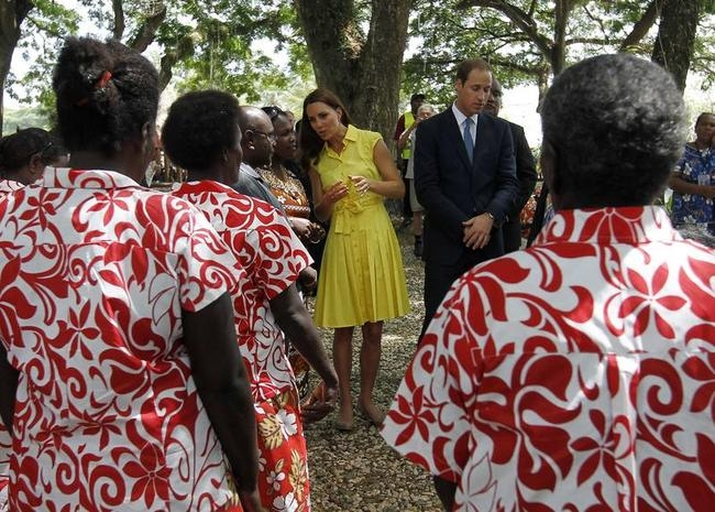 Britain's Prince William and his wife Catherine, the Duchess of Cambridge, watch a traditional chorus at the cultural village in Honiara