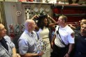 Serena Williams of the U.S. poses with firefighters in New York