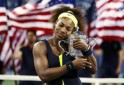 Williams of the U.S. poses with her trophy after defeating Azarenka of Belarus in their women's singles finals match at the U.S. Open tennis tournament in New York