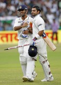 India's captain Dhoni and Kohli walk off the field together after India won the match and the series against New Zealand on the fourth day of their second test cricket match in Bangalore