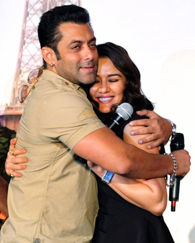 Salman Khan hugs Preity Zinta during the music launch of their upcoming film Ishkq in Paris, in Mumbai, on 17th September.