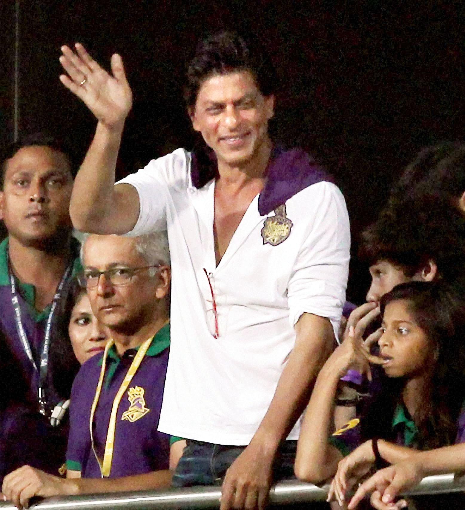 Kolkata Knight Rider owner Shah Rukh Khan waves to his fans during IPL T20 at Eden Garden in Kolkata