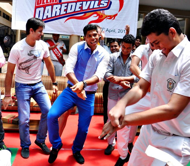 Delhi Daredevils stars Naman Ojha and Umesh Yadav dance with the school kids at DPS, Raipur. (Photo: BCCL)