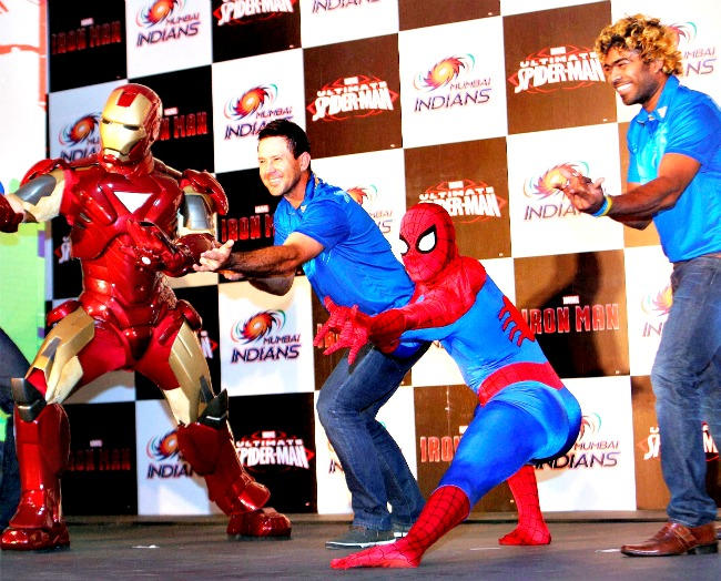 Mumbai Indians skipper Ricky Ponting and fast bowler Lasith Malinga pose with Marvel characters Ironman and Spiderman at the launch of Marvel Mumbai Indians merchandise in Mumbai on Sunday. (Photo: PTI)