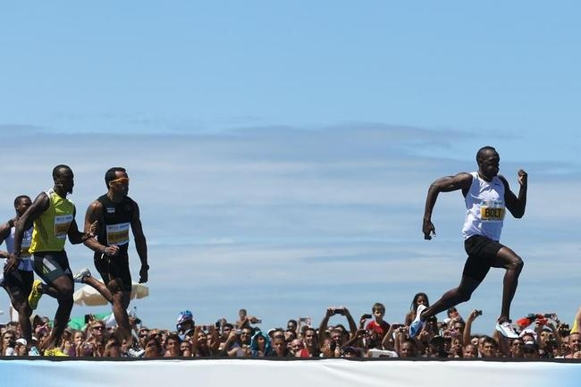 Usain Bolt Wins 150-Meter Race at Copacabana Beach