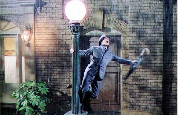Singin' In the Rain (1952) - A classic musical that shows the transition of the silent era into talkies in a comic manner, this is one of the best dance movies of all times. Gene Kelly, Debbie Reynolds and Donald O'Connor lit up the movie with their amazing dance steps. The combination of vaudeville and tap was memorable, and the title song especially has been copied and parodied over the years. One of the most feel-good movies, we begin our list with this one.