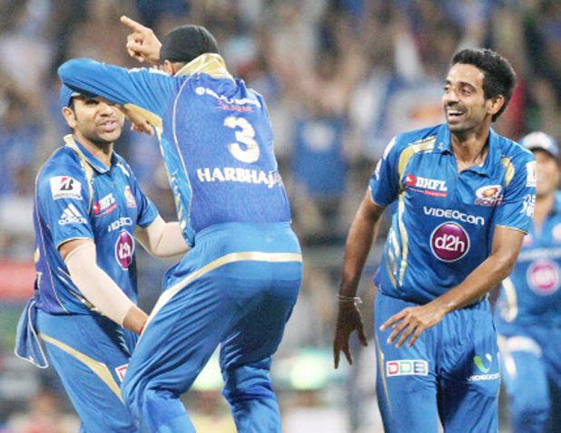 Mumbai Indians' Harbhajan Singh celebrates the dismissal of Royal Challengers Bangalore's Chris Gayle in Gangnam style during the IPL 6 match at the Wankhede Stadium in Mumbai. (Photo: PTI)