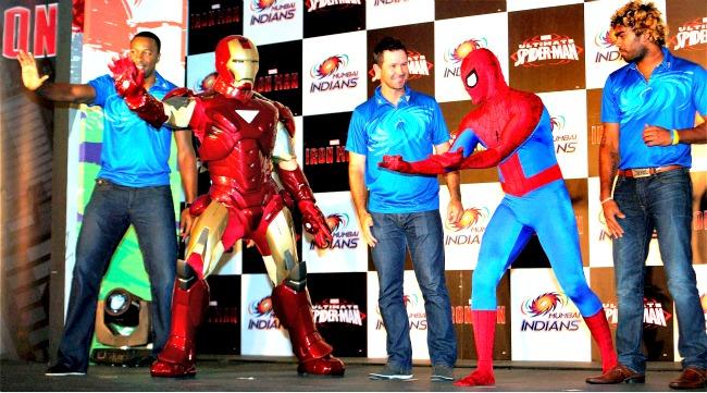 Kieron Pollard, Ponting and Malinga pose with Ironman and Spiderman. (Photo: PTI)