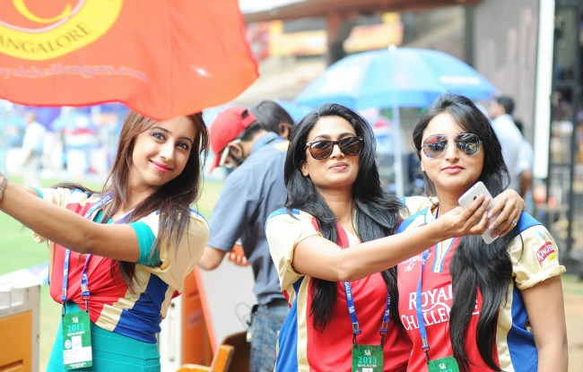 Actresses Sanjana, Swetha and Meghana during the IPL match at the M Chinnaswamy Stadium in Bangalore. (Photo: BCCL)