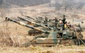 South Korean marines stand on K-55 self-propelled howitzers during an exercise against possible attacks by North Korea near the border village of Panmunjom in Paju, South Korea Monday, April 1, 2013. After weeks of war-like rhetoric, North Korean leader K