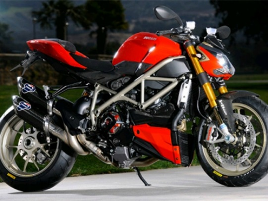 Ducati Streetfighter S  All you need to do is look at the image above to fall in love! This Ducati model literally looks like some sort of awesome transformer that even Michael Bay couldn't conceive.