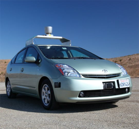 Google's Driverless Car  Google, in collaboration with the Nevada Department of Transportation, is currently working on developing an autonomous driving system for cars. If this project pans out, it will truly revolutionize road transport and minimize accidents.  This system works using data received from Google Street View, artificial intelligence software, internal cameras and a LIDAR optical ranging system placed on top of the vehicle. It has been successfully tested on some crowded streets and highways in America. However, we will be convinced only when this system prevails in Mumbai traffic!   Photo: guardian.co.uk