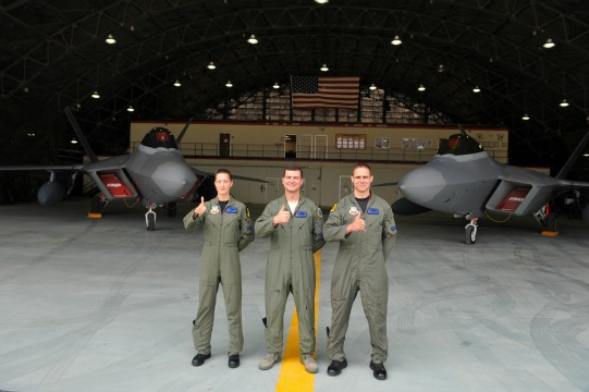Seven Expeditionary Fighter Squadron from Holloman airbase pose with F-22 Raptor fighter jets. Photo: AFP