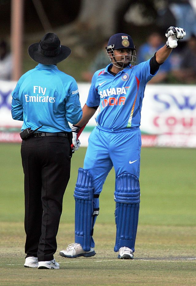 Indian batsman Suresh Raina (65*) acknowledges the applause from his team mates on reaching 50 runs during the 4th match of the 5-match cricket ODI series between Zimbabwe and India at Queen's Sports Club in Harare on August 1, 2013. (Photo: AFP)