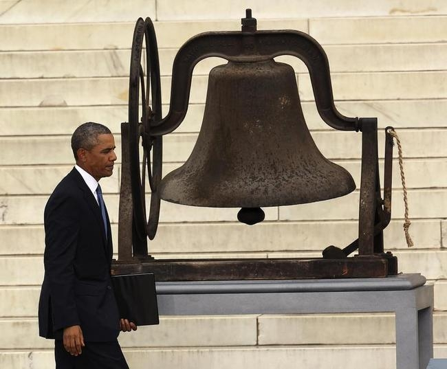 US President Obama walks past church bell before speaking at the Lincoln Memorial in Washington