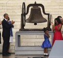 US President Obama applauds the ringing of a church bell while the daughter of Martin Luther King III holds her ears during ceremonies celebrating the anniversary of the