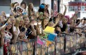 "One Direction fans shout as they wait for the premiere of the film ""One Direction: This is Us"", in London"