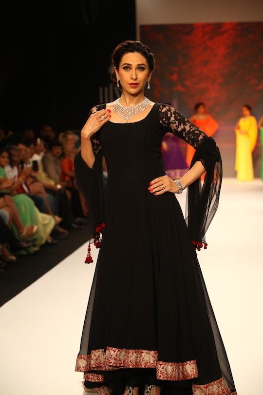 Karisma Kapoor in a black Manish Malhotra Anarkali ensemble wearing a gleaming diamond set