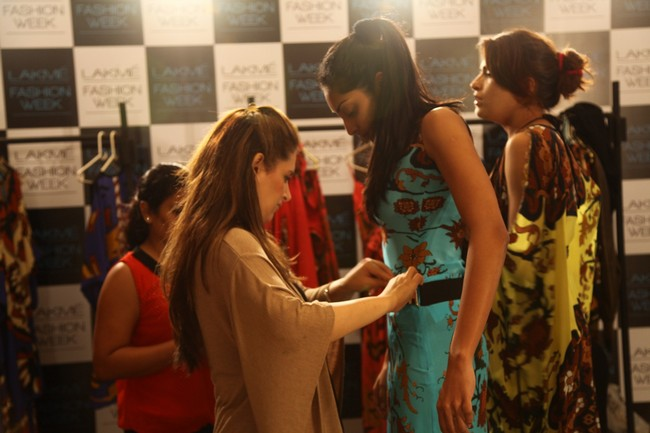 Models and designers are busy with fittings for the upcoming Lakme Fashion Week. Here are pictures of fittings on day 4... In pic: Designer Pria Kataria Puri busy with the fittings.