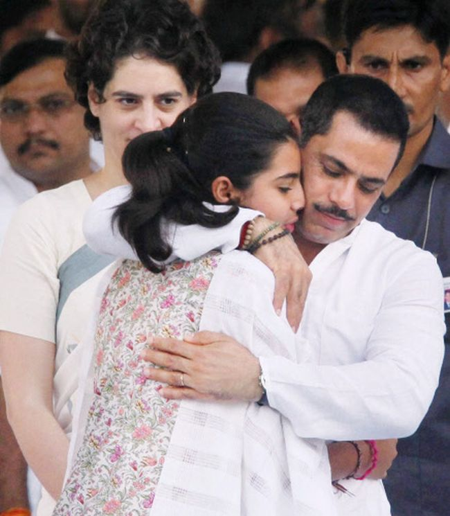 Priyanka Vadra and Robert Vadra with their daughter Miraya after paying  tribute to former Prime Minister Rajiv Gandhi on his 69th birth  anniversary at Vir Bhoomi in New Delhi