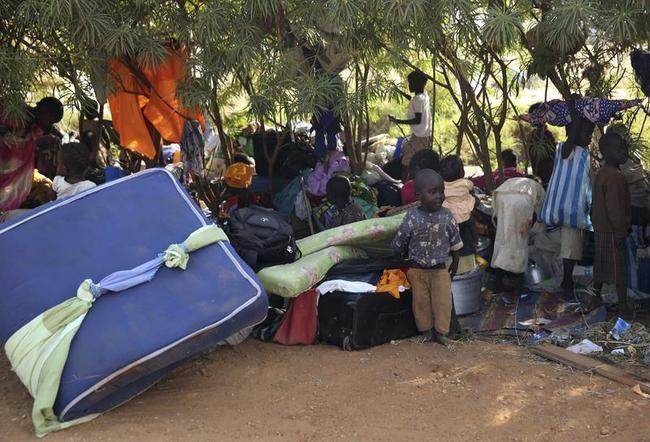 Internally displaced people sit inside UNMIS compound n Juba