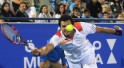 Jo-Wilfried Tsonga hits a return to Novak Djokovic during their semi-final tennis match at the Mubadala World Tennis Championship in Abu Dhabi