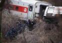 Officials remove a body from the scene of a Metro-North train derailment in the Bronx borough of New York