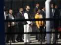 Rahul Gandhi, a lawmaker and son of India's ruling Congress party chief Sonia Gandhi, waits in a queue to cast his vote outside a polling station during the state assembly elections in New Delhi