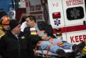 Metro-North engineer William Rockefeller Jr. is loaded into an ambulance after a train derailment in New York
