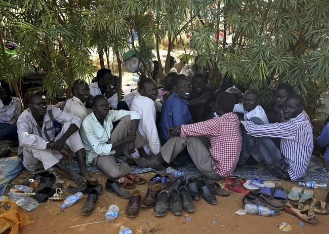 Internally displaced men sit inside a UNMIS compound in Juba