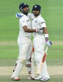 India 284/2; Pujara 135*, Kohli 77*