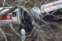 Emergency personnel remove a body following a Metro-North train derailment in the Bronx borough of New York