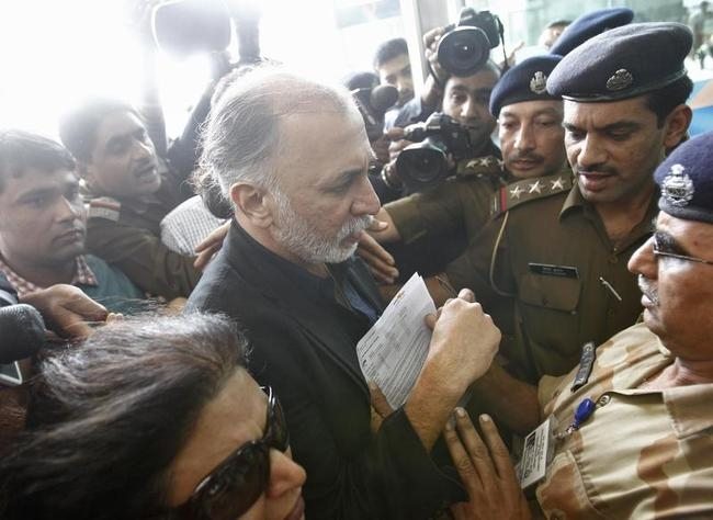 Tarun Tejpal is asked to produce his travel papers by CISF officers upon his arrival at the airport on his way to Goa, in New Delhi