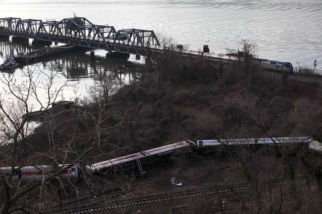 Train cars are seen at the site of a Metro-North train derailment in the Bronx borough of New York