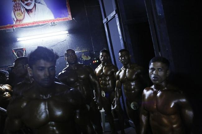 Competitors wait to get onstage during a bodybuilding competition in Mumbai