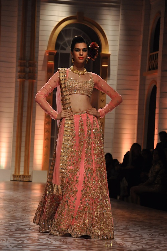 "Inspired by their travels to Monaco, Nice and the Gardens of Lake Como, Falguni and Shane Peacock displayed their ethereal ""Garden of Eden"" collection at the Aamby Valley India Bridal Fashion Week 2013.   It was a memorable and ultra-feminine journey for the audience as the designing duo's 2013 Peacock Bride label was a visual study in colour, fabric, form and style. Bringing onto the ramp the multi hues of the most beautiful gardens on earth, the palette revealed pistachio, pink, red, white, ivory, and gold."
