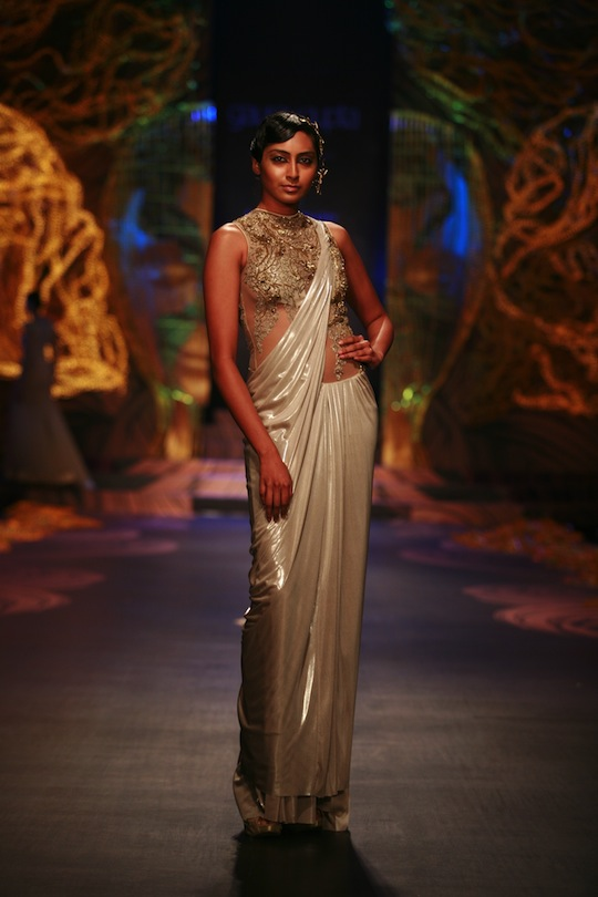 To highlight the theme of the show, Gaurav picked a colour story that started with moon grey, ecru, dust, gold, Egyptian teal and then finally to pop neon tones. His experiments with innovative silhouettes for gowns and the sari/lehenga combos showed a ma