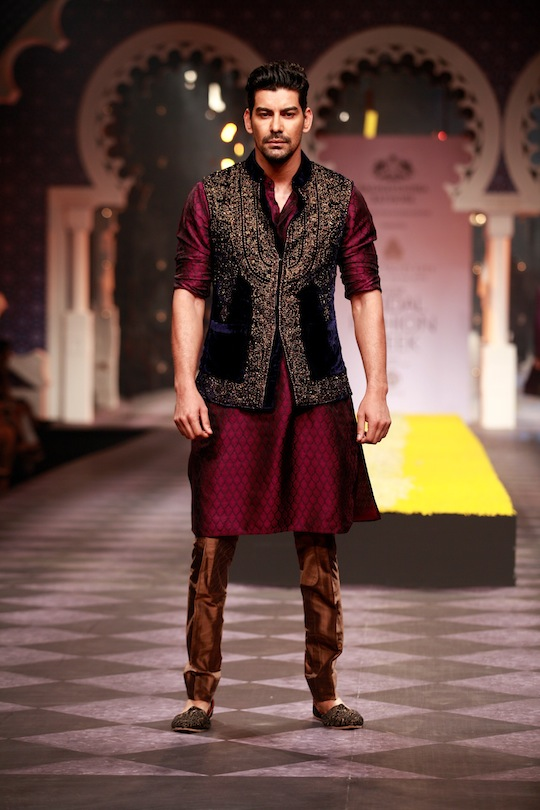 Giving men's wear his creative touches Raghavendra had a fuchsia kurta with a purple waist coat; bundies had tiny embroidery or were splashed lavishly with gold placement work. A bright red silk Bandgala, a vibrant pink Nehru jacket/kurta combo and shimmering velvet Bandgala offered variety.