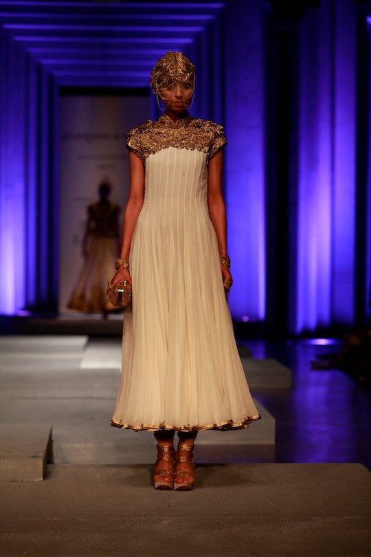 White drop-waist mermaid gowns with gold work, black empire line peplum blouses over net skirts and the gold and brown layered halter flamenco dresses with encrusted bodices revealed an international look for the creations. Red jersey sheaths had gold det