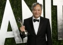 "Ang Lee holds his award for Best Director for ""Life of Pi"" at the 2013 Vanity Fair Oscars Party in West Hollywood"
