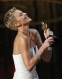 Charlize Theron holds the award before presenting it to Quentin Tarantino for best original screenplay at the 85th Academy Awards in Hollywood