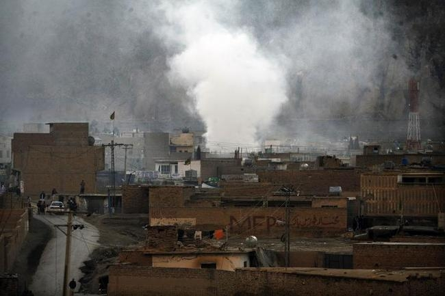Smoke rises after a bomb attack in a Shi