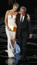 Presenters Charlize Theron and Dustin Hoffman take the stage at the 85th Academy Awards in Hollywood