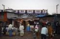 A train passes through slums in Mumbai
