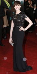 Hathaway poses as she arrives for the British Academy of Film and Arts awards ceremony at the Royal Opera House in London