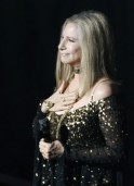 Barbra Streisand accepts the applause after performing the song