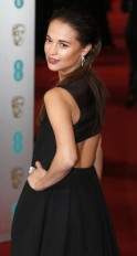 Alicia Vikander poses as she arrives for the British Academy of Film and Arts (BAFTA) awards ceremony at the Royal Opera House in London