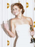 Jennifer Lawrence reacts as she poses with her Oscar after winning the Best Actress award for her role in